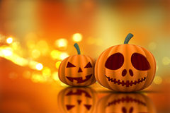 3D Halloween pumpkins on a bokeh lights background Royalty Free Stock Photo