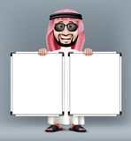 3D Handsome Saudi Arab Man in Traditional Dress. With Shades Stand Holding Two Blank White Board with Space for Text or Business Messages while Smiling and Royalty Free Stock Images