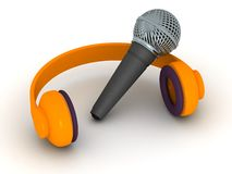 3D Headphones and Microphone. A 3D microphone and orange headphones, isolated on white Stock Photography
