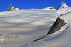 d'Herens dell'ammaccatura e del Matterhorn al tramonto Fotografia Stock Libera da Diritti