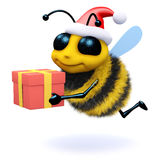 3d Honey bee holding a Christmas gift. 3d render of a bee wearing a Santa Claus hat and holding a Christmas gift Royalty Free Stock Photos