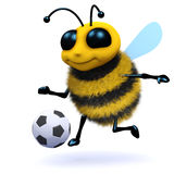 3d Honey bee soccer player. 3d render of a cute honey bee kicking a football Royalty Free Stock Photo