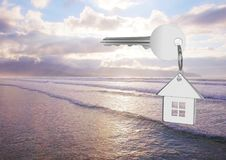 3D House key floating over sea Stock Photo