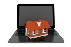 3d House over Laptop keyboard Stock Photos
