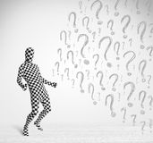 3d human character is body suit looking at hand drawn question m Royalty Free Stock Photo