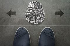 3d human metal brain on front of business man feet Royalty Free Stock Photo