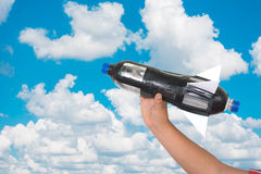 D.I.Y pressure rocket. Boy holding D.I.Y pressure rocket on cloudy sky  isolated on cloudy sky with clipping path Royalty Free Stock Photos
