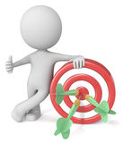 3D illustrated man with bulls eye. 3D computer generated illustrated man leaning on red and white bulls eye with green darts giving thumbs up sign Stock Photo