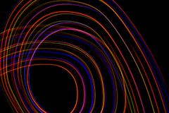 3d illustration. Abstract lines of light painting of reddish colors on black background. Abstract three-dimensional patterns royalty free stock photography