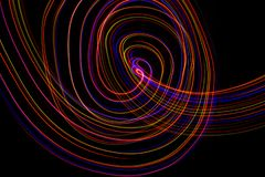 3d illustration. Abstract lines of light painting of reddish colors on black background. Abstract three-dimensional patterns stock image