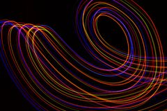 3d illustration. Abstract lines of light painting of reddish colors on black background vector illustration