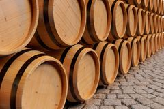 3D Illustration background wooden barrels wine. Alcoholic drink in wooden barrels, such as wine, cognac, rum, brandy. 3D Illustration background wooden barrels Royalty Free Stock Photography