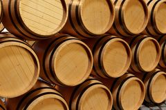 3D Illustration background wooden barrels wine. Alcoholic drink in wooden barrels, such as wine, cognac, rum, brandy. 3D Illustration background wooden barrels Royalty Free Stock Photo