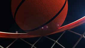 3D illustration of Basketball ball falling in a hoop.  Royalty Free Stock Photography