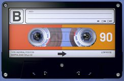 Black, orange and white audio cassette with sticker and label stock images