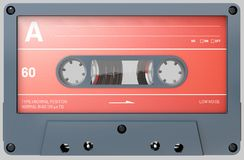 Black and red audio cassette with sticker and label stock image