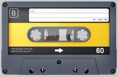 Black and yellow audio cassette with sticker and label stock photography