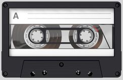 Black and transparent audio cassette with sticker and label royalty free stock photo