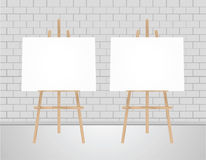 3D illustration  blank canvas on a wooden. Two Vector Wooden Brown  Easel with Mock Up Empty Blank Horizontal Canvas Standing on Floor in front of   Wall Stock Photos