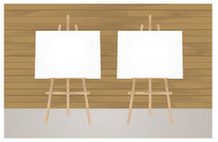 3D illustration  blank canvas on a wooden. Two Vector Wooden Brown  Easel with Mock Up Empty Blank Horizontal Canvas Standing on Floor in front of   Wall Royalty Free Stock Images