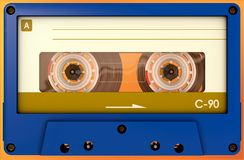 Blue and yellow audio cassette with sticker and label stock image