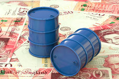 3d illustration: Blue barrels of oil lie on the background of banknote of British pound sterling. Money. Petroleum business Royalty Free Stock Image