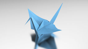 3D illustration blue origami bird. On a grey background Stock Image