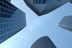 3D Illustration blue skyscrapers from a low angle view. Architecture glass high buildings. Blue skyscrapers in a finance. District royalty free illustration