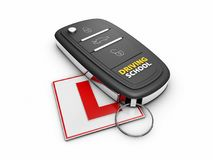3d Illustration of car key on the white learner driver sign.  Stock Photo