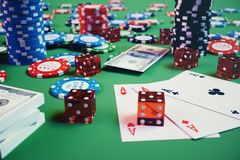3D illustration casino game. Chips, playing cards for poker. Poker chips, red dice and money on green table. Online. Casino concept Stock Image