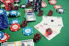 3D illustration casino game. Chips, playing cards for poker. Poker chips, red dice and money on green table. Online. Casino concept Royalty Free Stock Photo