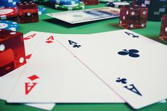 3D illustration casino game. Chips, playing cards for poker. Poker chips, red dice and money on green table. Online. Casino concept Stock Photos