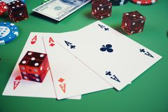 3D illustration casino game. Chips, playing cards for poker. Poker chips, red dice and money on green table. Online. Casino concept Royalty Free Stock Photography