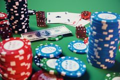 3D illustration casino game. Chips, playing cards for poker. Poker chips, red dice and money on green table. Online. Casino concept Royalty Free Stock Images