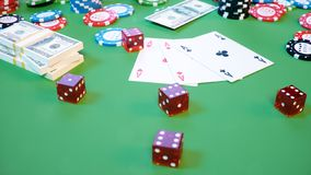 3D illustration casino game. Chips, playing cards for poker. Poker chips, red dice and money on green table. Online stock illustration