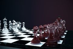 3D illustration Chess game on board. Concepts business ideas and strategy ideas. Glass chess figures on a dark. Background with depth of field effects Royalty Free Stock Images