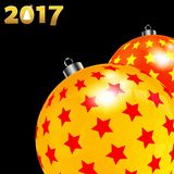 Christmas decorated red and yellow baubles on black. 3D Illustration of Christmas Decorated Baubles Red and Yellow with Stars Over Black Background with Date in Royalty Free Stock Photography