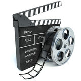 3d illustration of cinema clap and film reel, over white. Background royalty free illustration