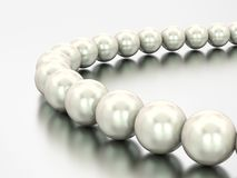 3D illustration close up white pearl necklace beads. On a grey background Stock Photo