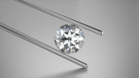 3D illustration closeup diamond in tweezers. On a grey background Stock Photos