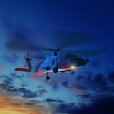 3d illustration of coast guard helicopter in sunset sky. Stock Photo