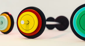3d illustration of colorful gym barbells stock photos