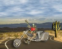 3D Illustration of Colorful Robotic Biker on Desert Road. On bright sunny day Stock Images