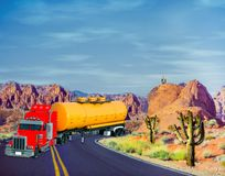 3D Illustration of colorful tanker truck traveling across desert highway. With vivid colors and blue sky Royalty Free Stock Photo