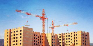 3d illustration of cranes building a brick house. 3D modeling Royalty Free Stock Photos