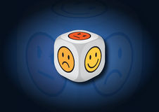 A 3D illustration of a dice with emotion symbols Stock Photography