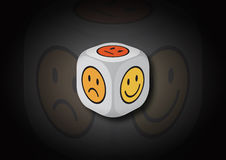 A 3D illustration of a dice with emotion symbols Royalty Free Stock Images