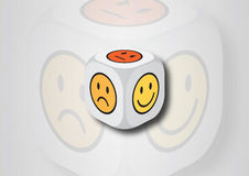 A 3D illustration of a dice with emotion symbols Royalty Free Stock Photography