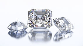 3D Illustration drei asscher Diamantstein stock abbildung
