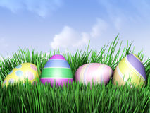 3D illustration of Easter eggs hiding in Fresh Green Grass. Stock Image